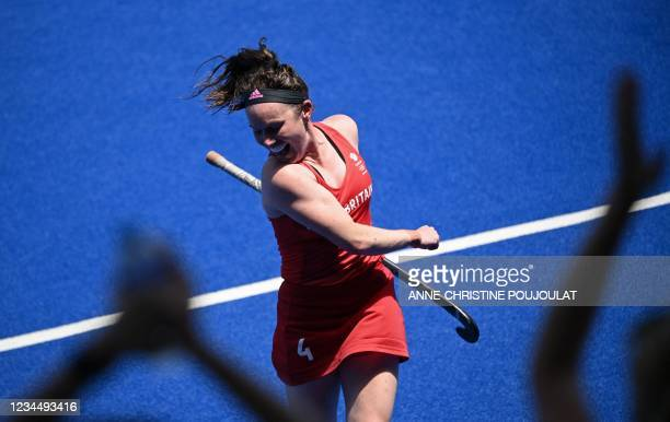 Britain's Laura Unsworth celebrates after winning the women's bronze medal match of the Tokyo 2020 Olympic Games field hockey competition by...