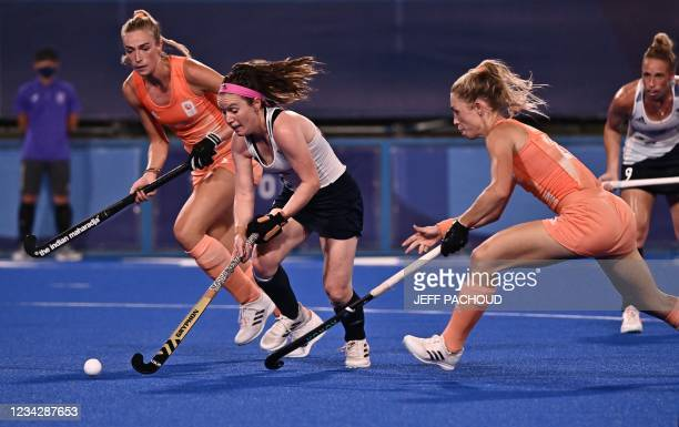 Britain's Laura Unsworth is tackled by Netherlands' Laura Maria Nunnink during their women's pool A match of the Tokyo 2020 Olympic Games field...