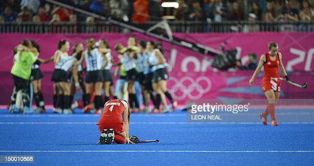 Britain's Laura Unsworth sits on the pitch after Team GB lose to Argentina in the women's hockey semi final at the Riverbank Arena in the Olympic...