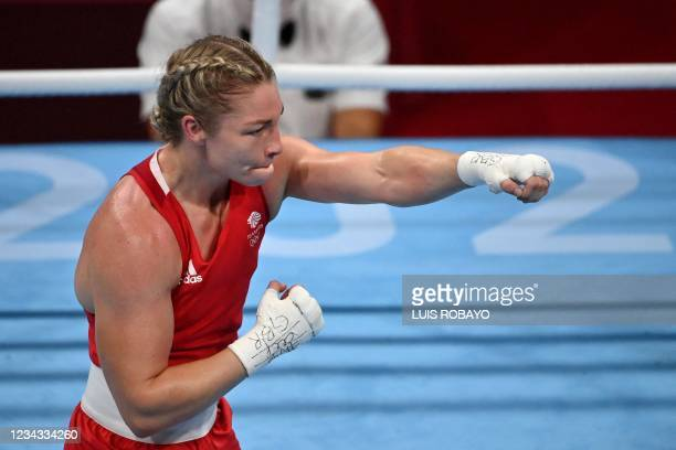 Britain's Lauren Price celebrates after winning against Panama's Atheyna Bylon after their women's middle quarter-final boxing match during the Tokyo...