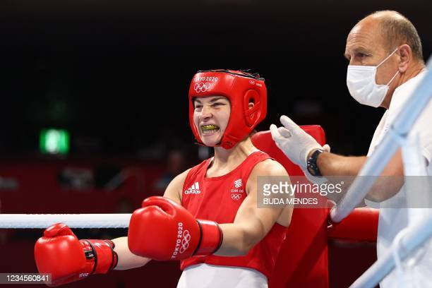 Britain's Lauren Price reacts as she fights China's Li Qian during their women's middle boxing final bout during the Tokyo 2020 Olympic Games at the...