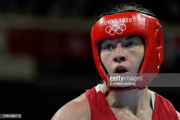 Britain's Lauren Price reacts as she fights Netherlands' Nouchka Fontijn during their women's middle semi-final boxing match during the Tokyo 2020...