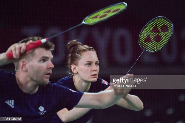 Britain's Lauren Smith looks on in her mixed doubles badminton group stage match with Britain's Marcus Ellis against France's Thom Gicquel and...