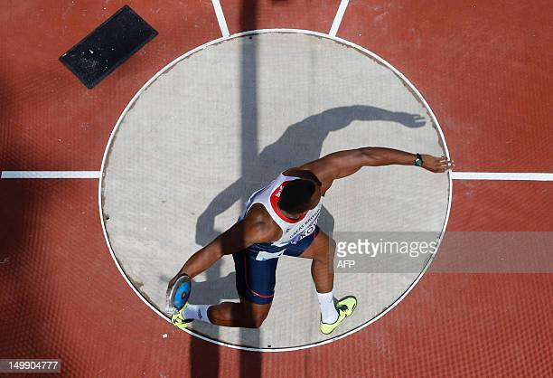 Britain's Lawrence Okoye competes in the men's discus throw qualifications during the London 2012 Olympic Games at the Olympic Stadium on August 6...