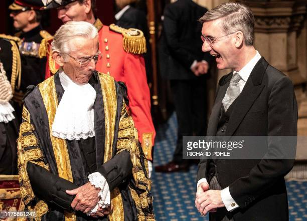 Britain's Leader of the House of Commons Jacob ReesMogg laughs as he shares a joke with the speaker of the House of Lords Norman Fowler as he attends...