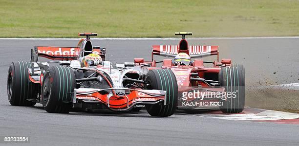 Britain's Lewis Hamilton of McLaren-Mercedes and Brazil's Felipe Massa of Ferrari collide on a chicane during Formula One's Japanese Grand Prix at...