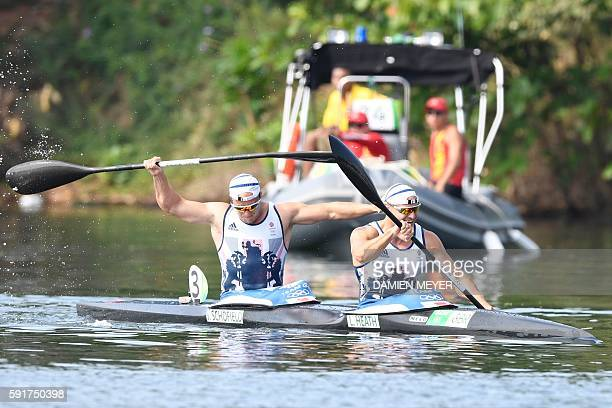 Britain's Liam Heath and Jon Schofield celebrate after the Men's Kayak Double 200m final at the Lagoa Stadium during the Rio 2016 Olympic Games in...