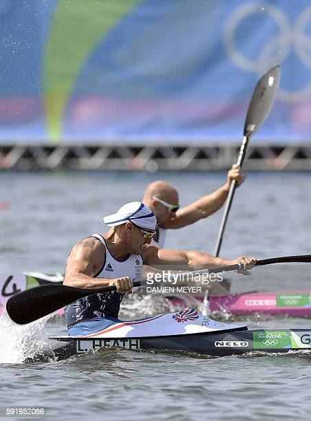 Britain's Liam Heath wins ahead of Germany's Ronny Rauhe in the Men's Kayak Single 200m event at the Lagoa Stadium during the Rio 2016 Olympic Games...