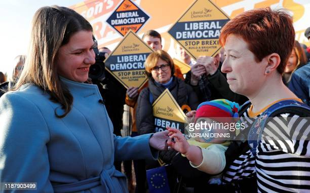 Britain's Liberal Democrat leader Jo Swinson talks with supporter Doctor Francesca Cappelluto and Elizabeth Brown during a general election campaign...