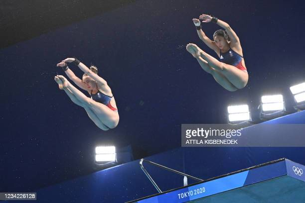 Britain's Lois Toulson and Britain's Eden Cheng compete in the women's synchronised 10m platform diving final event during the Tokyo 2020 Olympic...