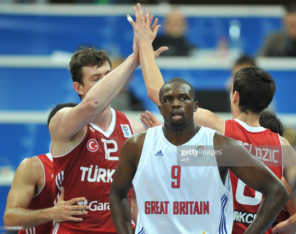 Britain's Luol Deng (C) looks on as Turk : News Photo