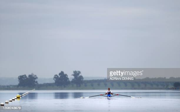 Britain's Maddie Arlett rows in a single scull during a GB rowing team training camp in Avis central Portugal on February 12 2020 British Olympic...