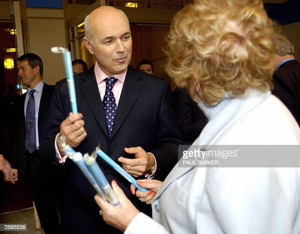 Britain's main opposition Conservative Party leader Iain Duncan Smith is given a stick of conservative party rock a gaudy jawaching confection of...