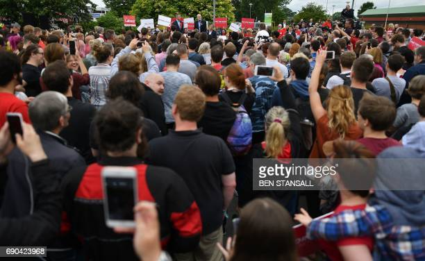 TOPSHOT Britain's main opposition Labour party leader Jeremy Corbyn addresses supports during a general election campaign rally in Reading west of...