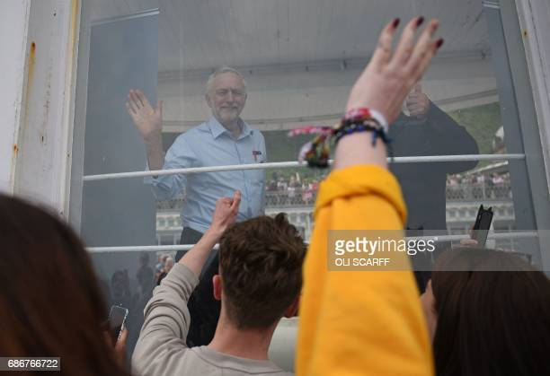 Britain's main opposition Labour Party leader Jeremy Corbyn acknowledges supporters after speaking during a general election campaign event in...