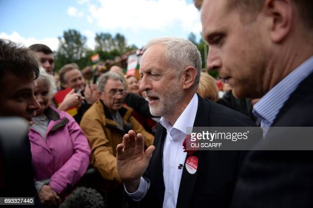 Britain's main opposition Labour Party leader Jeremy Corbyn arrives to speak at a campaign rally in Halton northwest England on June 7 on the eve of...