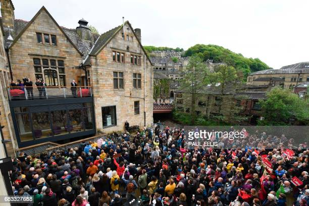 Britain's main opposition Labour Party leader Jeremy Corbyn delivers a speech to a crowd from the balcony of the Town Hall at Hebden Bridge northern...