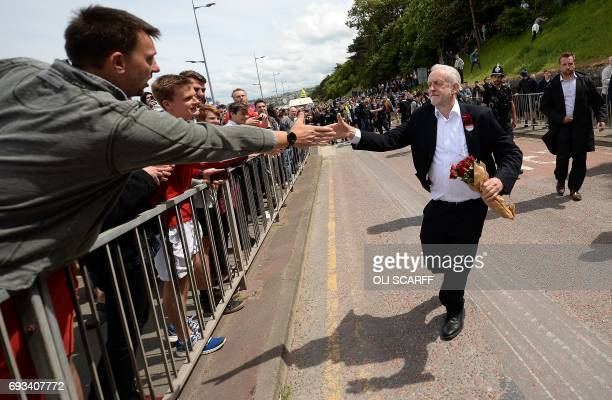 Britain's main opposition Labour Party leader Jeremy Corbyn greets supporters as he leaves after attending a campaign visit in Colwyn Bay north Wales...