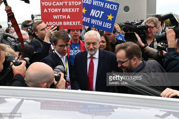 Britain's main opposition Labour Party leader Jeremy Corbyn leaves after an interview with the BBC during the Labour party conference in Brighton on...