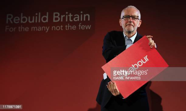 TOPSHOT Britain's main opposition Labour Party leader Jeremy Corbyn poses after speaking during a rally in central London on October 14 following the...