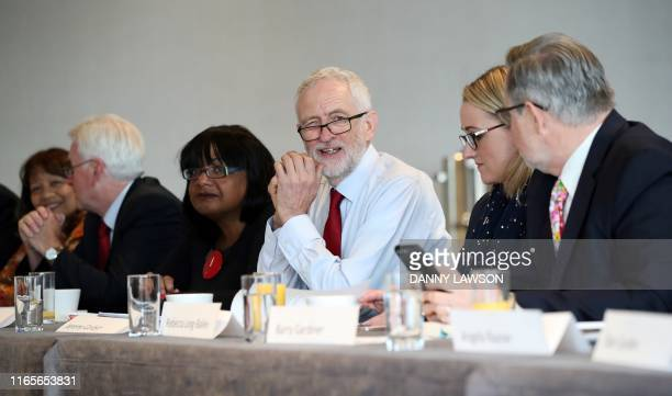Britain's main opposition Labour Party leader Jeremy Corbyn poses for a photograph as he sits with Shadow Leader of the House of Commons Valerie Vaz...