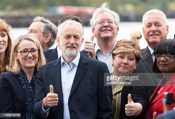 Britain's main opposition Labour Party leader Jeremy Corbyn poses for a photograph with members of his Shadow Cabinet on The Quays in Salford...