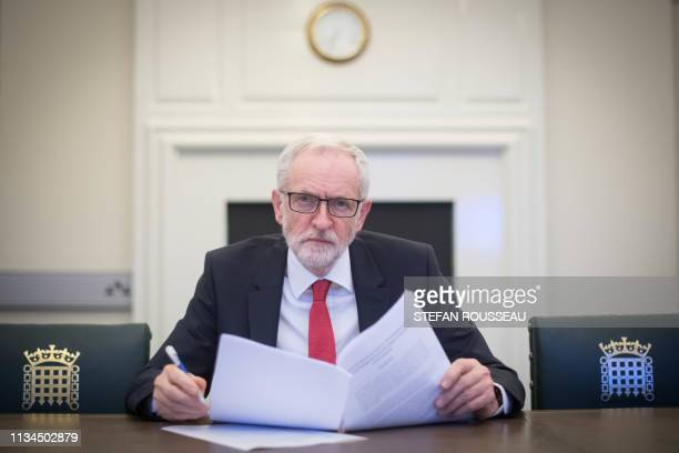 TOPSHOT Britain's main opposition Labour Party leader Jeremy Corbyn poses with a copy of the Political Declaration setting out the framework for the...