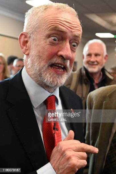 Britain's main opposition Labour Party leader Jeremy Corbyn reacts as he meets with supporters after delivering a speech on his party's plans for...
