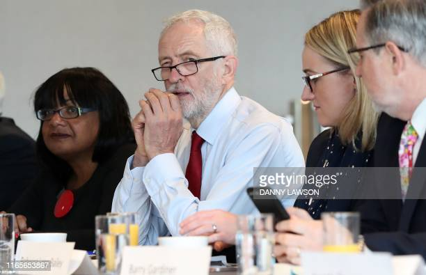 Britain's main opposition Labour Party leader Jeremy Corbyn sits with Shadow Home Secretary Diane Abbott Shadow Business Secretary Rebecca LongBailey...