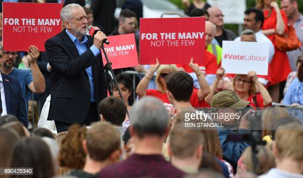 Britain's main opposition Labour party leader Jeremy Corbyn speaks during a general election campaign rally in Reading west of London on May 31 as...