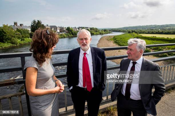 Britain's main opposition Labour party leader Jeremy Corbyn talks with Professor Deirdre Heenan and Shadow Secretary of State for Northern Ireland...