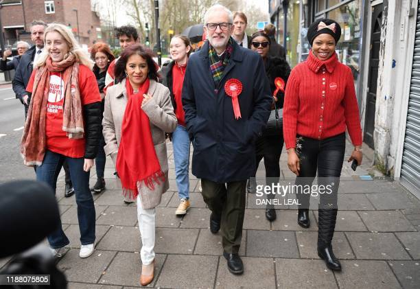 Britain's main opposition Labour Party leader Jeremy Corbyn walks to a Polling Station to cast his ballot paper and vote in north London on December...