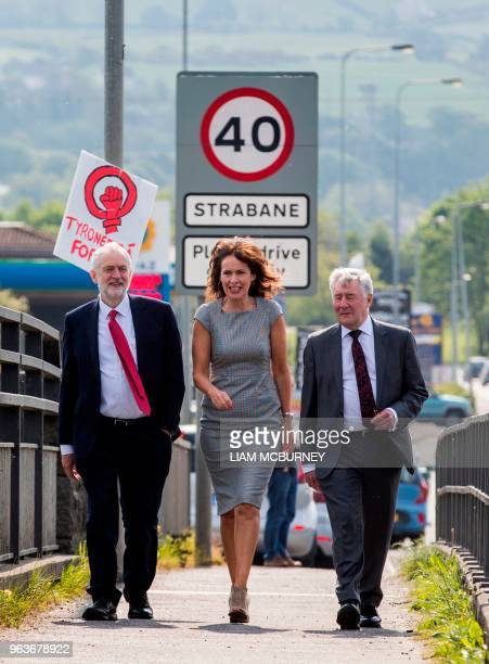 Britain's main opposition Labour party leader Jeremy Corbyn walks with Professor Deirdre Heenan and Shadow Secretary of State for Northern Ireland...