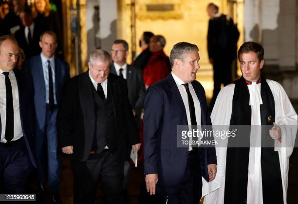 Britain's main opposition Labour Party leader Keir Starmer speaks to a member of the clergy after attending a service of remembrance and prayer in...