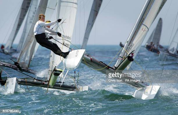 Britain's Mark Bulkeley and Leigh McMillan put the power on rounding the first windward mark before winning a silver medal in the Tornado class at...