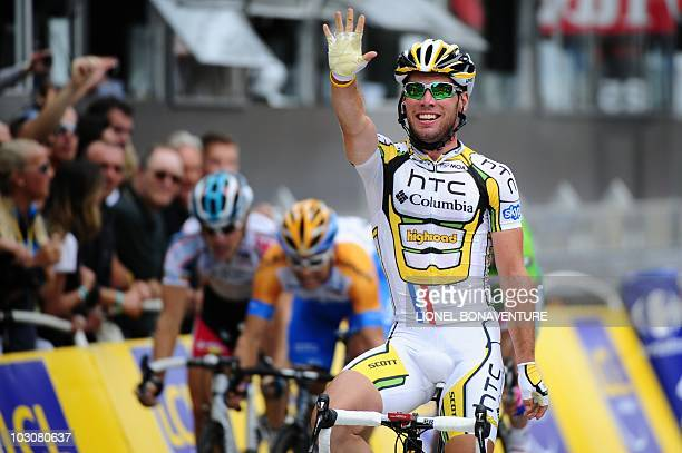 Britain's Mark Cavendish celebrates on the finish lineas he wins ahead of NewZealand's Julian Dean at the end of the 1025 km and last stage of the...