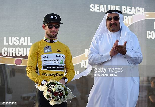 Britain's Mark Cavendish of Dimension Data team receives the gold jersey from the President of the Qatar Cycling Federation Sheikh Khalid Bin Ali...
