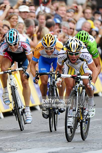 Britain's Mark Cavendish sprints on the finish lineas he wins ahead of Italy's Alessandro Petacchi NewZealand's Julian Dean and Belgium's Jurgen...