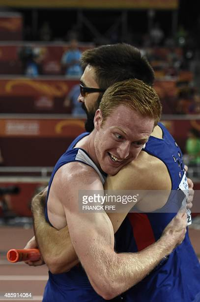 Britain's Martyn Rooney hugs teammate Jarryd Dunn during celebrations at the end of the final of the men's 4x400 metres athletics event at the 2015...