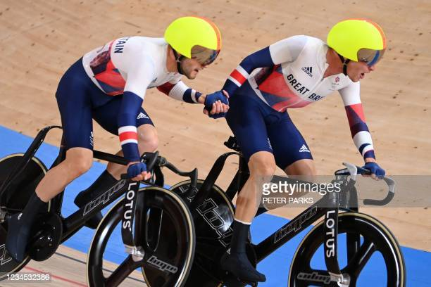 Britain's Matthew Walls and Britain's Ethan Hayter in action in the men's track cycling madison final during the Tokyo 2020 Olympic Games at Izu...