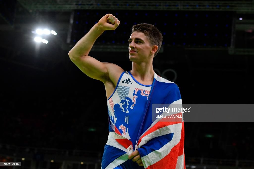 TOPSHOT - Britain's Max Whitlock celebrates after winning the men's pommel horse event final of the Artistic Gymnastics at the Olympic Arena during the Rio 2016 Olympic Games in Rio de Janeiro on August 14, 2016. / AFP PHOTO / Ben STANSALL