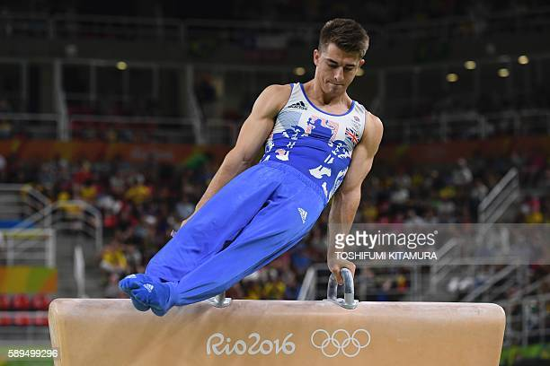 Britain's Max Whitlock competes in the men's pommel horse event final of the Artistic Gymnastics at the Olympic Arena during the Rio 2016 Olympic...