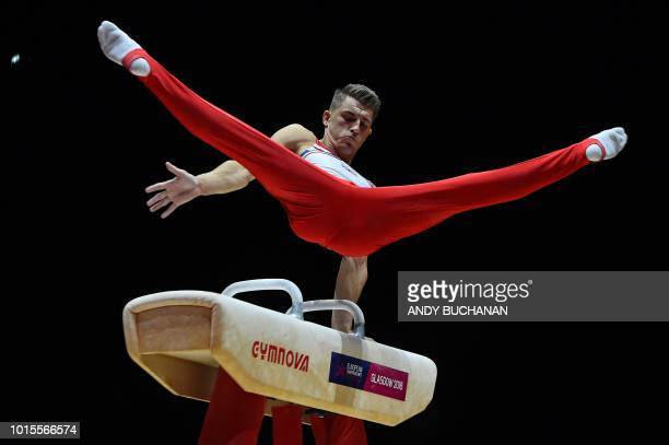 TOPSHOT Britain's Max Whitlock competes in the men's pommel horse final of the artistic gymnastics at the SSE Hydro during the 2018 European...