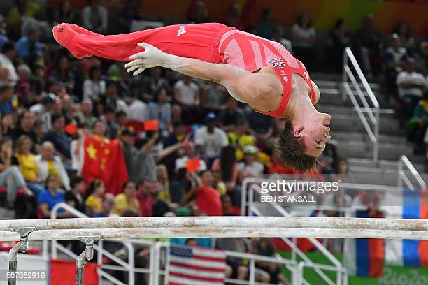 TOPSHOT Britain's Max Whitlock competes in the parallel bars of the men's team final of the Artistic Gymnastics at the Olympic Arena during the Rio...