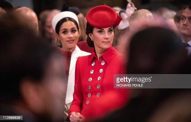 Britain's Meghan Duchess of Sussex and Britain's Catherine Duchess of Cambridge attend the Commonwealth Day service at Westminster Abbey in London on...