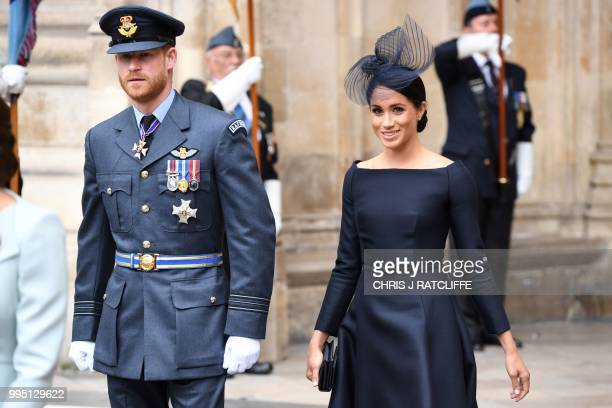 Britain's Meghan, Duchess of Sussex and Britain's Prince Harry, Duke of Sussex leave a service to mark the centenary of the Royal Air Force at...