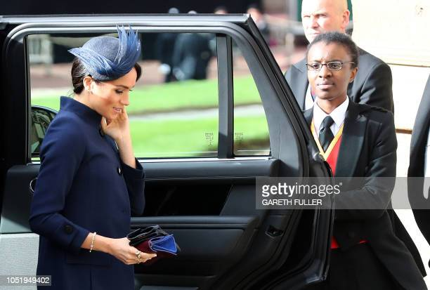 Britain's Meghan Duchess of Sussex arrive to attend the wedding of Britain's Princess Eugenie of York to Jack Brooksbank at St George's Chapel...