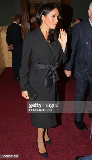 Britain's Meghan Duchess of Sussex arrives to attend the annual Royal British Legion Festival of Remembrance at the Royal Albert Hall in London on...
