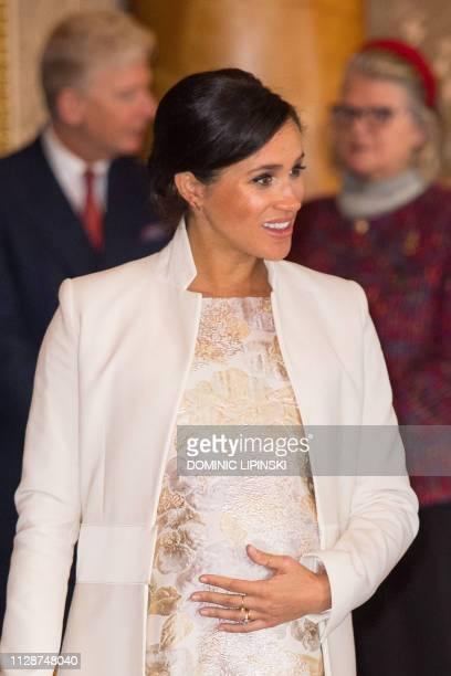Britain's Meghan Duchess of Sussex attends a reception to mark the 50th Anniversary of the investiture of The Prince of Wales at Buckingham Palace in...