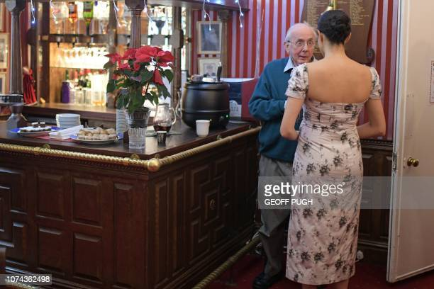 Britain's Meghan Duchess of Sussex chats with actor Richard O'Sullivan during her visit to the Royal Variety Charity's residential nursing and care...